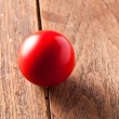Red ball on wood background — Stock Photo #74636005