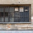 Постер, плакат: Old window with bars