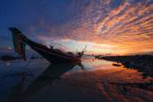 Fishing boat at sunset — Stock Photo
