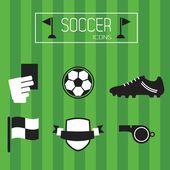 Black and white soccer icons set on green striped background — Stockvektor