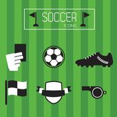 Black and white soccer icons set on green striped background — Stock Vector