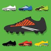 Soccer shoes icons set with shadow on green background — Stock Vector