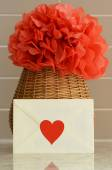 Vase basket with red tissue paper flower and a love letter — Foto de Stock