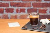 Cup of coffee with bill — Stockfoto