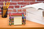 Desk with school supplies and colored pencil — Stock fotografie