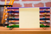 Desk with school supplies and colored pencil — Foto de Stock