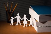 Desk with family in paper in night — Stock Photo