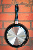 Frying pan with black handle — Stockfoto