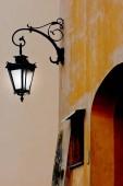 A luminous  lantern is in evening city — Stockfoto