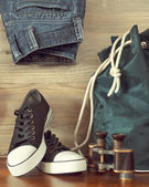 Shoes, backpack, jeans and  binoculars — Stock Photo