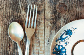 The spoon, a fork and a plate — Stock Photo