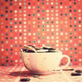 Cup full of badges — Стоковое фото
