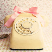 Telephone with pink bow — Stock Photo