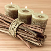 Aromatherapy sticks with candles — Stock Photo