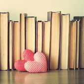Hearts and old books — Stock Photo
