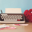 Vintage typewriter and bouquet of roses — Stock Photo #63101309