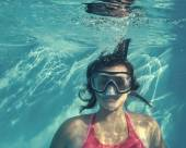 Girl swimming underwater — Stock Photo