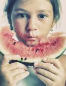 Girl eating a slice of watermelon — Stock Photo
