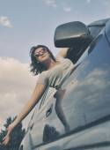 Girl looks out the window when riding in a car — Stock Photo