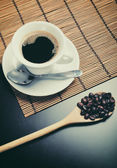 Hot espresso with coffee beans — Stock Photo