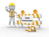 Human character and under construction — Stock Photo