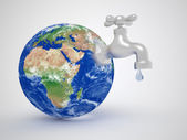 Earth globe and tap — Stock Photo