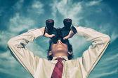 Business man looking through binocular — Stock Photo