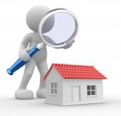 Person with magnifying glass and house — Stock Photo