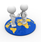 People standing on world map and shaking hands — Stock Photo