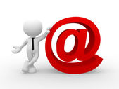 Man and a email symbol — Stock Photo