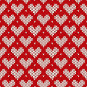 Seamless knitted pattern with hearts. Valentine's Day background — Stockvektor