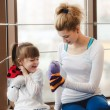 Mother and daughter playing with toys in the gym — Stock Photo #65453819