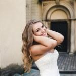 Beautiful bride posing against the backdrop of a European city — Stok fotoğraf #65941147