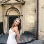 Beautiful bride posing against the backdrop of a European city — Stok fotoğraf #65941155