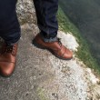 Feet of Men  in selvedge jeans and retro shoes — Stock Photo #66863163