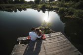 Beautiful couple  at the lake — Stock Photo