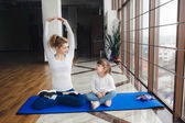 Mother and daughter makeing yoga — Stock Photo
