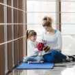 Mother and daughter playing with toys in the gym — Stock Photo #74562201