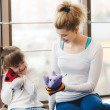 Mother and daughter playing with toys in the gym — Stock Photo #74562217