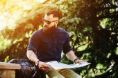 Bearded man looking at a map — Stock Photo
