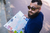 Bearded man with a map in hand — Stock Photo