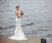 Bride at the lake — Stock Photo