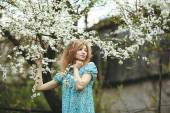 Portrait of a beautiful girl flowering trees — Stock Photo