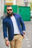 Stylish bearded man walks through the city — Stock Photo