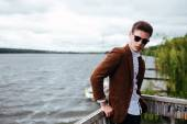 Man in sunglasses posing on the pier — Stock Photo