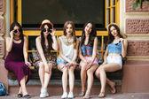 Five beautiful young girls relaxing — Stock Photo