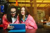 Two close friends watching something on a tablet — Stock Photo