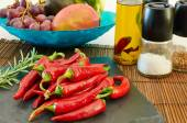 Some red hot chili peppers on a slate tray — Stock Photo