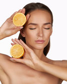 Beautiful sexy young woman with perfect healthy skin and long brown hair day makeup bare shoulders holding orange lemon grapefruit healthy eating organic food diet weight loss — Stock Photo