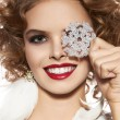 Beautiful girl with evening makeup smile take cristal snowflake — Stock Photo #59394637